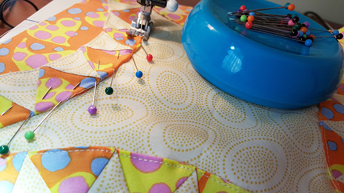 Remove pins BEFORE sewing over them. Sewing on a pin will bend, damage or break the needle.