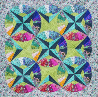Close up of the Fandango Quilt by Tula Pink & Stacey in Stitches and free motion quilted by Angela Walters