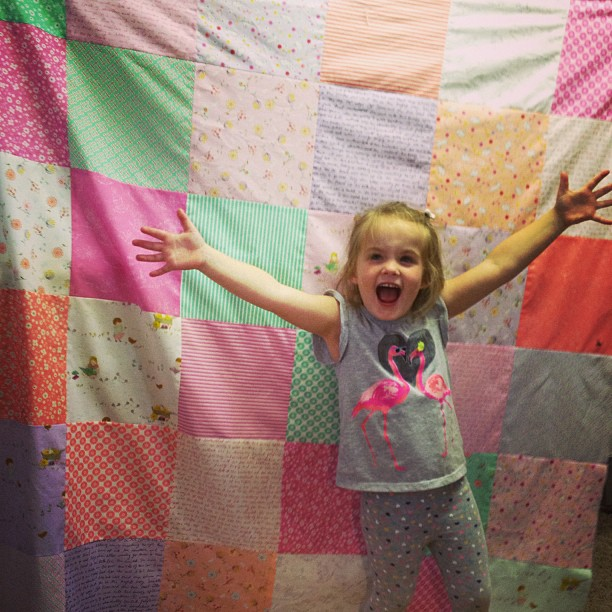 Kristi's daughter Remy with her first quilt!