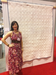 Sari of Sariditty with her Spirals Quilt, featuring all 270 colors of our 40wt thread!