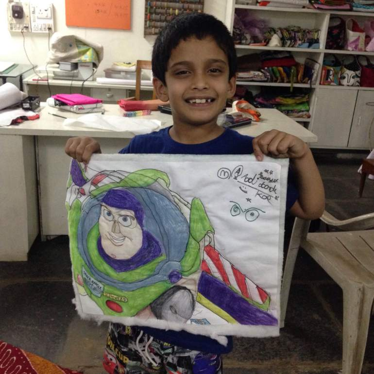 Aadi learns to quilt.jpg
