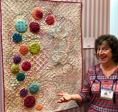 Karen showcasing her Quilter's Doodle mini at Aurifil's Spring Quilt Market booth