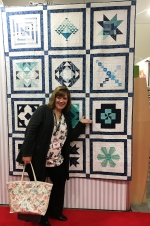 Jacquelynne Steves pointing to her block int he 2016 Aurifil DOM Quilt