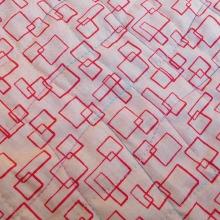 Thread detail on orange serbert