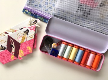 Storing English paper piecing supplies in a tin by BlossomHeartQuilts.com