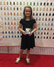 Remy with her collection at the 2017 International Quilt Market in Houston